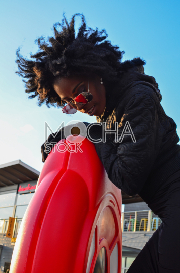 Stylish Young African American Woman in Sunglasses