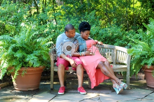 Pregnant Woman in Park with Husband