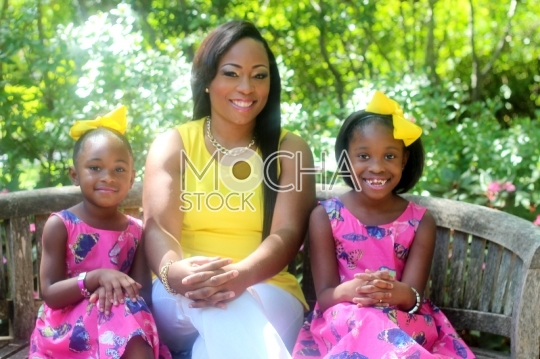 African American Mother Smiling with Daughters
