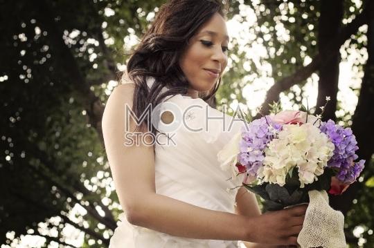 African American Bride Holding Flowers Bouquet