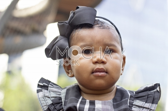 Cute African American Baby with Bow