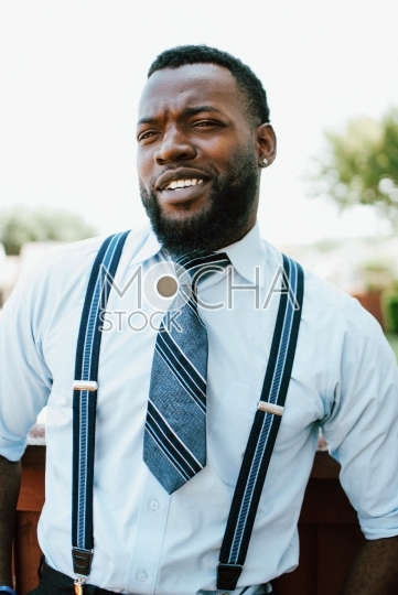 Handsome African American Man in Tie and Suspenders