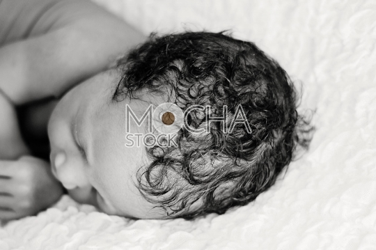 Sleeping Baby with Curly Hair