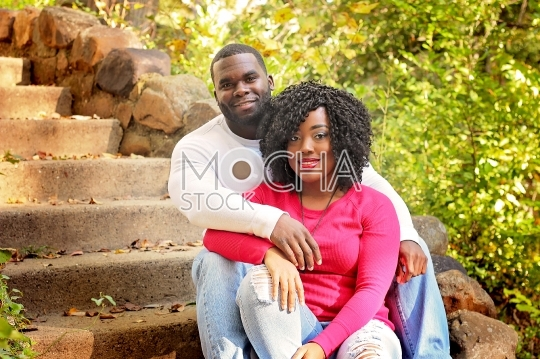 Smiling African American Couple Seated Outdoors