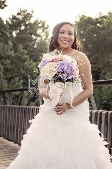 Smiling African American Bride with Flower Bouquet