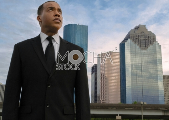 African American executive Standing Near to Downtown Skyline