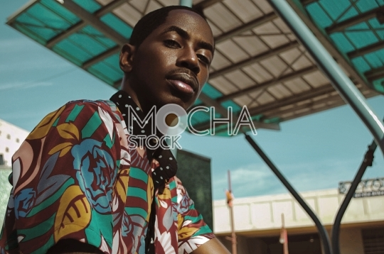 African American Man in Colorful Shirt