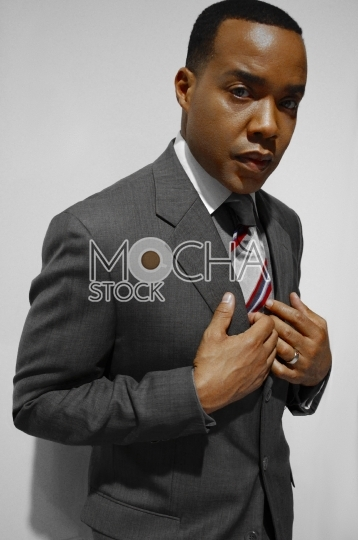 Dapper Black Business Man in Suit and Tie