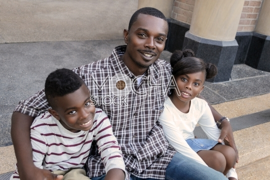 Happy African American Father and Children