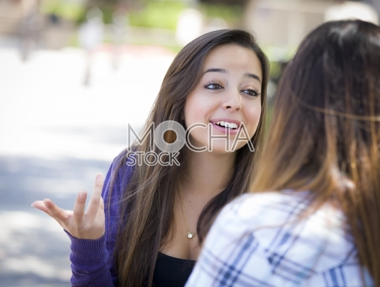 Expressive Young Mixed Race Woman Talking with Friend