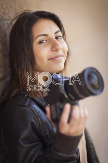 Mixed Race Young Female Photographer Holding Camera