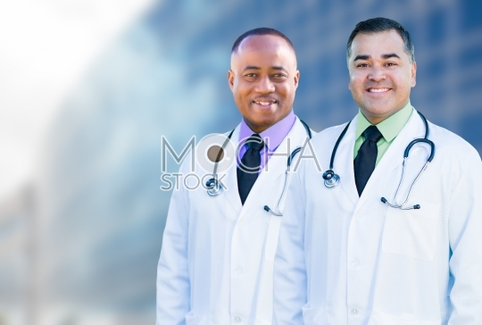 African American and Hispanic Male Doctors Outside of Hospital