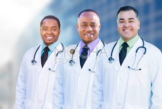 African American and Hispanic Male Doctors Posing Near Hospital