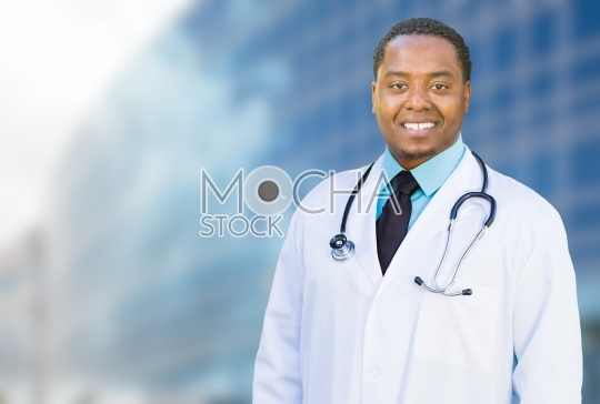 African American Male Doctor Outside of Hospital Building