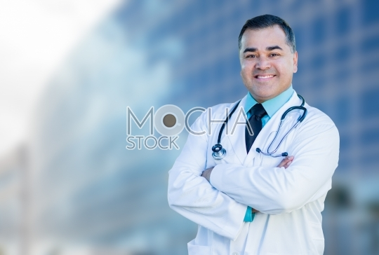Hispanic Male Doctor or Nurse In Front Of Hospital