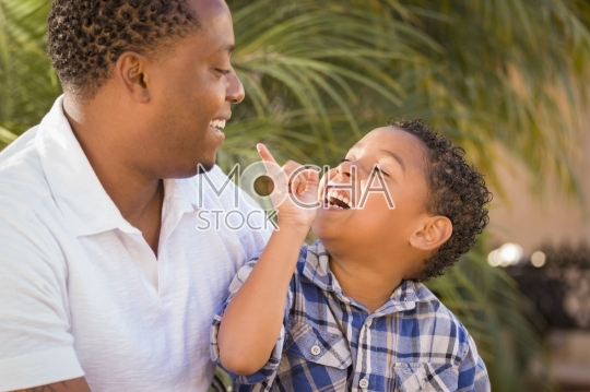 Happy Mixed Race Father and Son Playing