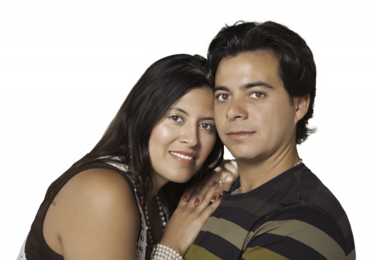 Attractive Hispanic Couple Portrait Isolated on White