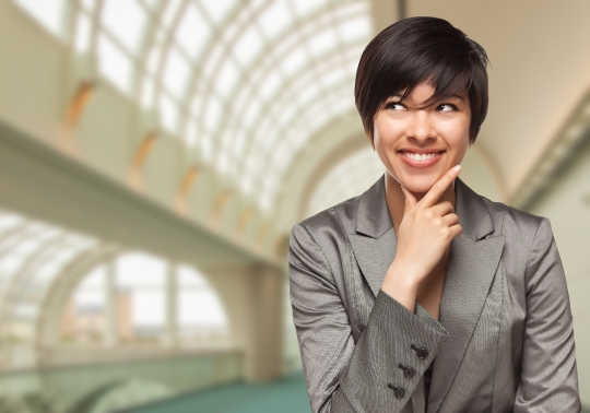 Businesswoman Inside Corporate Building Looking To The Side