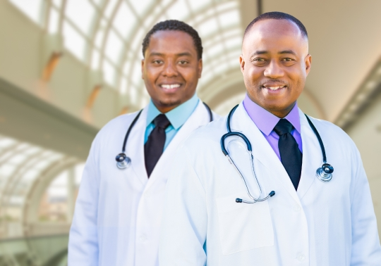 Two African American Male Doctors Inside Hospital Office