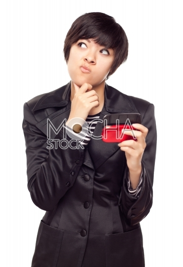 Pensive Young Mixed Race Woman with Cell Phone on White
