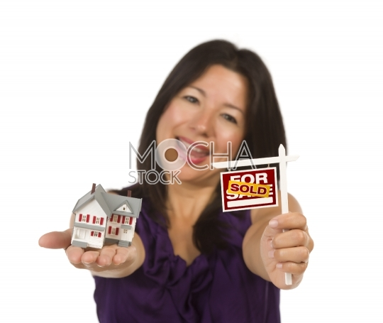 Multiethnic Woman Holding Small Sold For Sale Real Estate Sign a