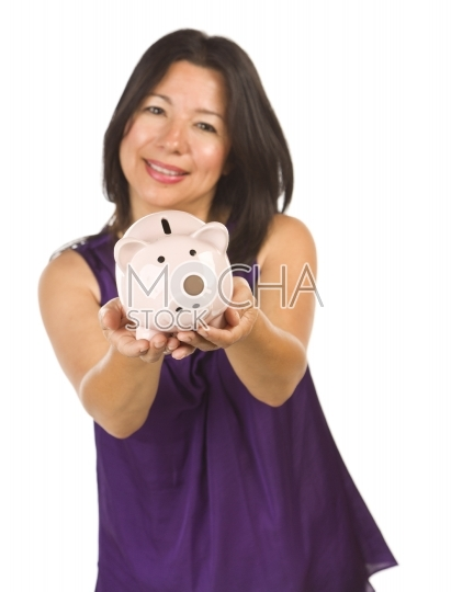 Smiling Hispanic Woman Holding Piggy Bank on White