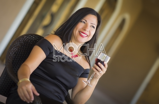 Attractive Hispanic Woman Portrait Outside Enjoying Wine