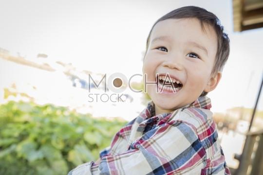 Mixed Race Young Boy Having Fun Outside