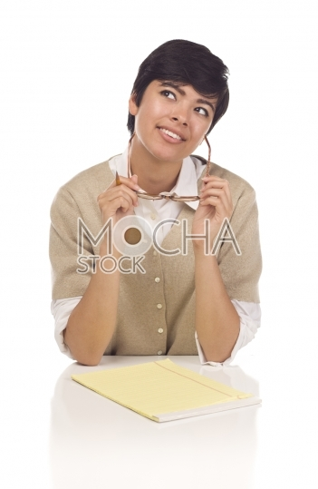 Daydreaming Hispanic Young Adult Female Student at Table