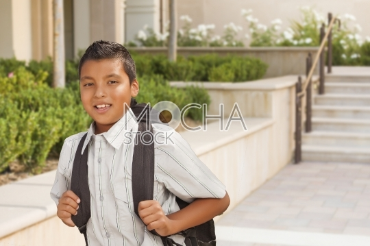 Happy Hispanic Boy with Backpack Walking on School Campus