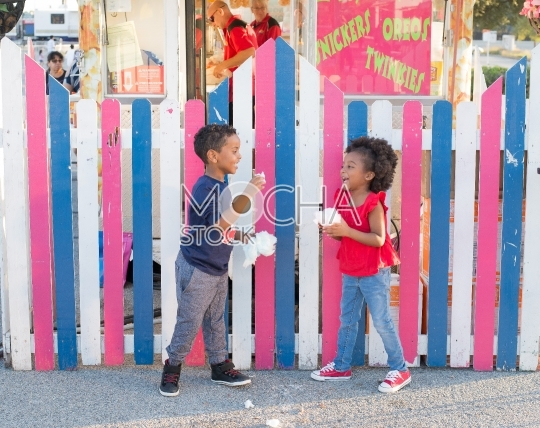 Children Enjoying Cotton Candy at State Fair