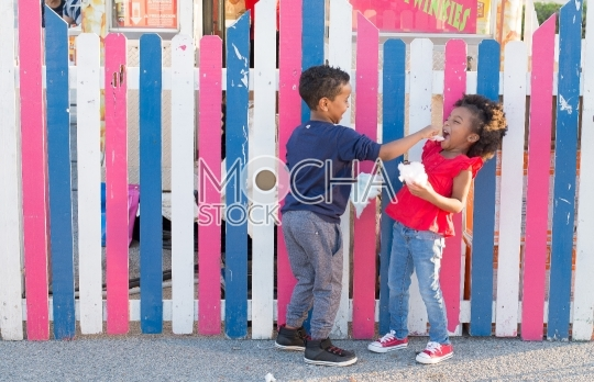 Kids at Fair Enjoying Cotton Candy