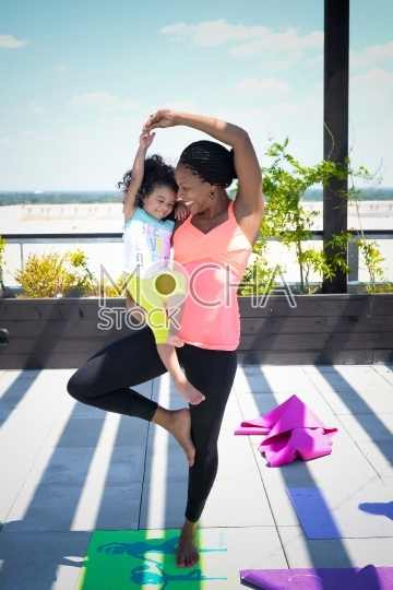 Mom and Young  Daughter Practicing Yoga