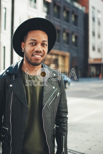 Hip young man wearing hat and leather jacket