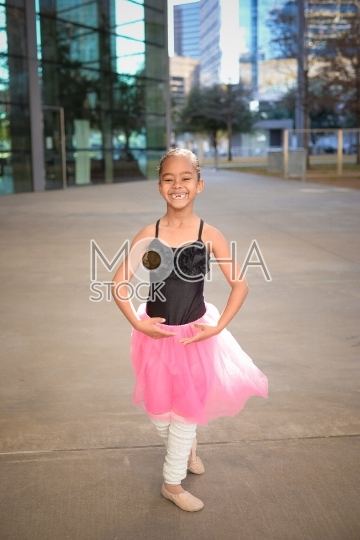 Young Ballerina in Tutu Posing