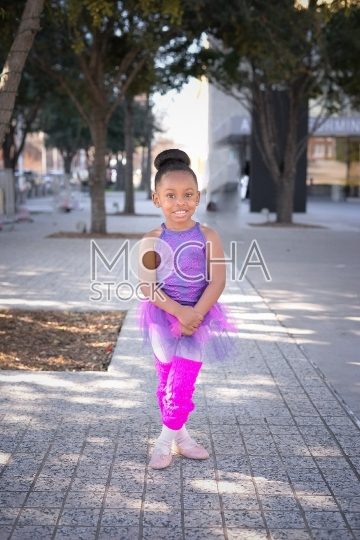 Adorable Little Ballerina on Her Way to Dance Class