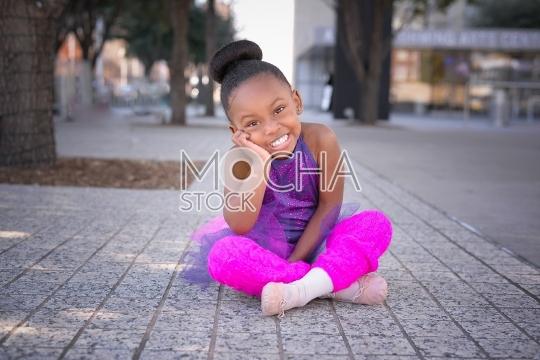 Beautiful Little Ballerina Smiles at Camera