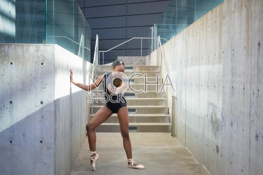 Girl wearing a leotard doing ballet