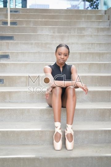 Young Ballerina Posing on Staircase