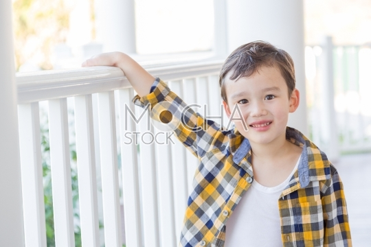 Young Mixed Race Boy on His Front Porch