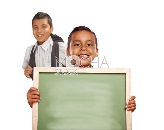 Hispanic Boys Holding Blank Chalk Board on White Background