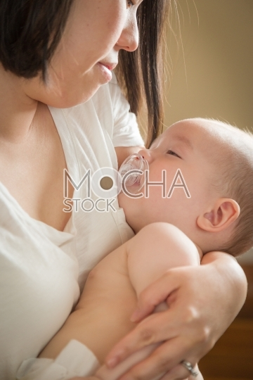 Mixed Race Chinese and Caucasian Baby Boy with His Mother