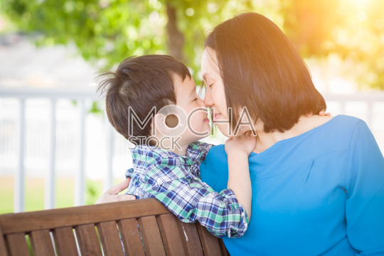 Outdoor Portrait of Chinese Mother with Her Mixed Race Chinese a