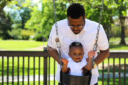 Father Pushes Son in Swing