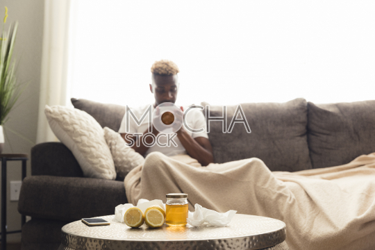 man with flu on couch