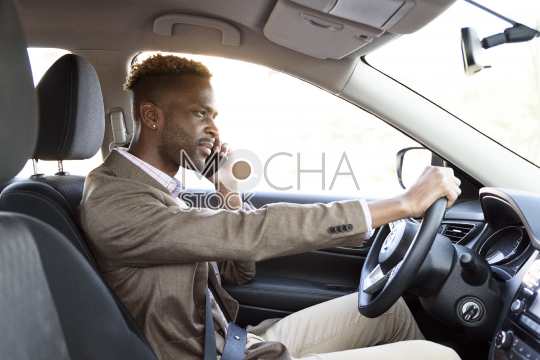 man in car on the phone