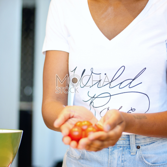Woman holding cherry tomatoes