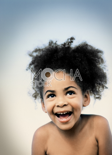 Smiling young girl with curly black hair