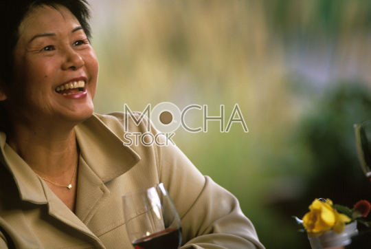Smiling mid adult woman sitting in her favorite restaurant