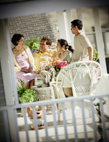 Family sitting together on patio